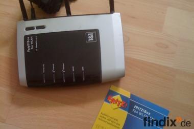 Fritzbox 7270 V2 mit CD und Netzkabel